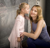 Portrait of teacher with pupil at blackboard Stock Photo