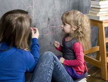 Portrait of teacher with pupil at blackboard Royalty Free Stock Image