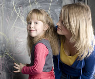 Portrait of teacher with pupil at blackboard Royalty Free Stock Photo