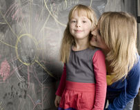 Portrait of teacher with pupil at blackboard Royalty Free Stock Photography