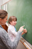 Portrait of a teacher and a pupil making an addition Royalty Free Stock Photography