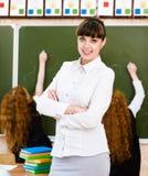 Portrait of teacher standing near blackboard Royalty Free Stock Images