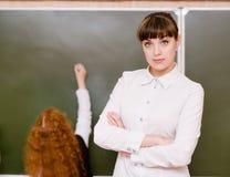 Portrait of teacher standing near blackboard Royalty Free Stock Photo