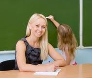 Portrait of teacher standing near blackboard Stock Images