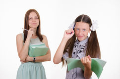 Portrait of a teacher and student with notebooks Stock Photo