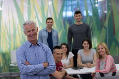 Portrait of  teacher with students group in background Royalty Free Stock Image