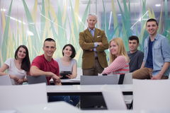 Portrait of  teacher with students group in background Royalty Free Stock Images