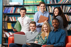 Portrait Of Teacher With Students In Library Royalty Free Stock Photos