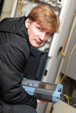 Portrait of technician. With optical reflectometer at server room Royalty Free Stock Photo
