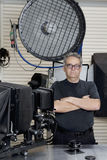 Portrait of a technician with arms crossed standing in photographer's studio Royalty Free Stock Photo