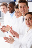 Portrait Of Technician And Colleagues In Laboratory Clapping Stock Image