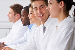 Portrait Of Technician In Laboratory With Colleagues Royalty Free Stock Photo