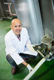 Portrait of technician near cisterns with milk Royalty Free Stock Image