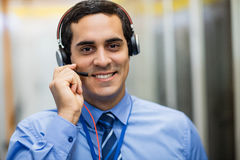 Portrait of technician talking on head phones. Portrait of happy technician talking on head phones Royalty Free Stock Images