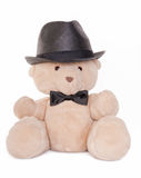Portrait of teddy bear with bow tie and hat. Sitting teddy bear wearing a bow tie and hat isolated on white Royalty Free Stock Photos