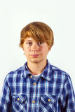 Portrait of a teen boy with blonde hair wearing a checked shirt Stock Images