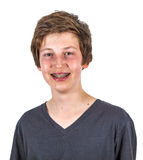 Portrait of a teen boy with braces in studio Stock Photos