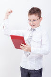 Portrait of teen boy with calculator on white Stock Image