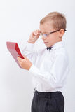 Portrait of teen boy with calculator on white Royalty Free Stock Image