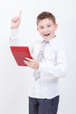 Portrait of teen boy with calculator on white Stock Photos