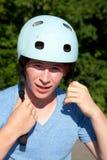 Portrait of a teen boy with a helmet. Portrait of cute teen boy locking his helmet Royalty Free Stock Image
