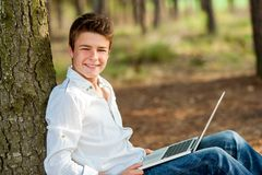 Portrait of teen boy with laptop. Royalty Free Stock Image
