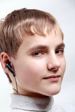 Portrait Teen Boy listening to headphones Royalty Free Stock Photo