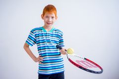 Boy playing tennis. A portrait of teen boy playing tennis Stock Photography