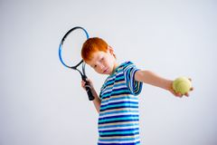 Boy playing tennis. A portrait of teen boy playing tennis Royalty Free Stock Photography