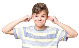 Portrait of teen boy. Silly boy making grimace - funny monkey face. Child with big ears, isolated on white background. Emotional portrait of caucasian teenager Stock Images