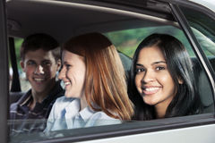 Portrait of teen in car. Teenagers riding in car in backseat Royalty Free Stock Images