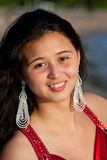 Portrait of a Teen girl. A pretty teen girl in sparkling earings smiling Royalty Free Stock Photos