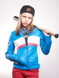 Portrait of a teen girl with bat. Studio shot Royalty Free Stock Images
