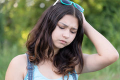 Portrait of teen girl busy problems in summer nature Royalty Free Stock Photography