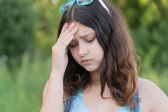 Portrait of teen girl busy problems in summer nature Stock Image