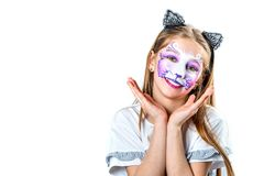 Portrait of teen girl with cat face painting. Portrait of cute teen girl with face painting of a cat posing in front of camera isolated on a white background stock images