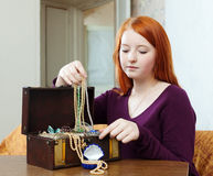Portrait of teen girl chooses jewelry Stock Photography