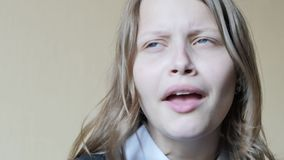 Portrait of a teen girl with a curious suspicious face. 4K UHD stock footage
