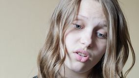 Portrait of a teen girl with a curious suspicious face. 4K UHD stock video