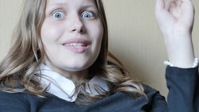 Portrait of a teen girl with a curious suspicious face. 4K UHD. Native video stock footage