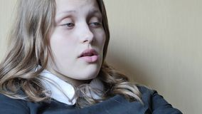 Portrait of a teen girl with a curious suspicious face. 4K UHD. Native video stock video