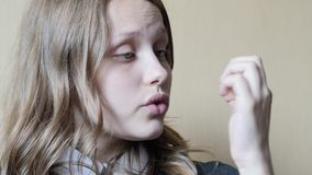 Portrait of a teen girl with a curious suspicious face. 4K UHD stock video footage