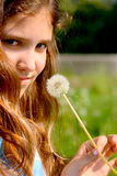 Portrait teen girl with dandelion. On nature Royalty Free Stock Photography