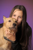 Portrait teen girl with a dog Stock Images