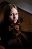 Portrait of a teen girl with dog Royalty Free Stock Images