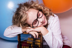 Portrait of teen girl dreaming in glasses with eyes closed again Royalty Free Stock Image