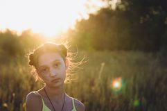 Portrait of teen girl in a field at sunset royalty free stock image