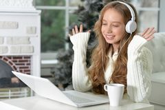 Teen girl with laptop. Portrait of teen girl in headphones with laptop Stock Photography