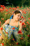 Portrait teen girl with poppy Royalty Free Stock Photos