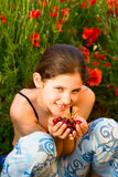 Portrait teen girl with poppy Stock Photos